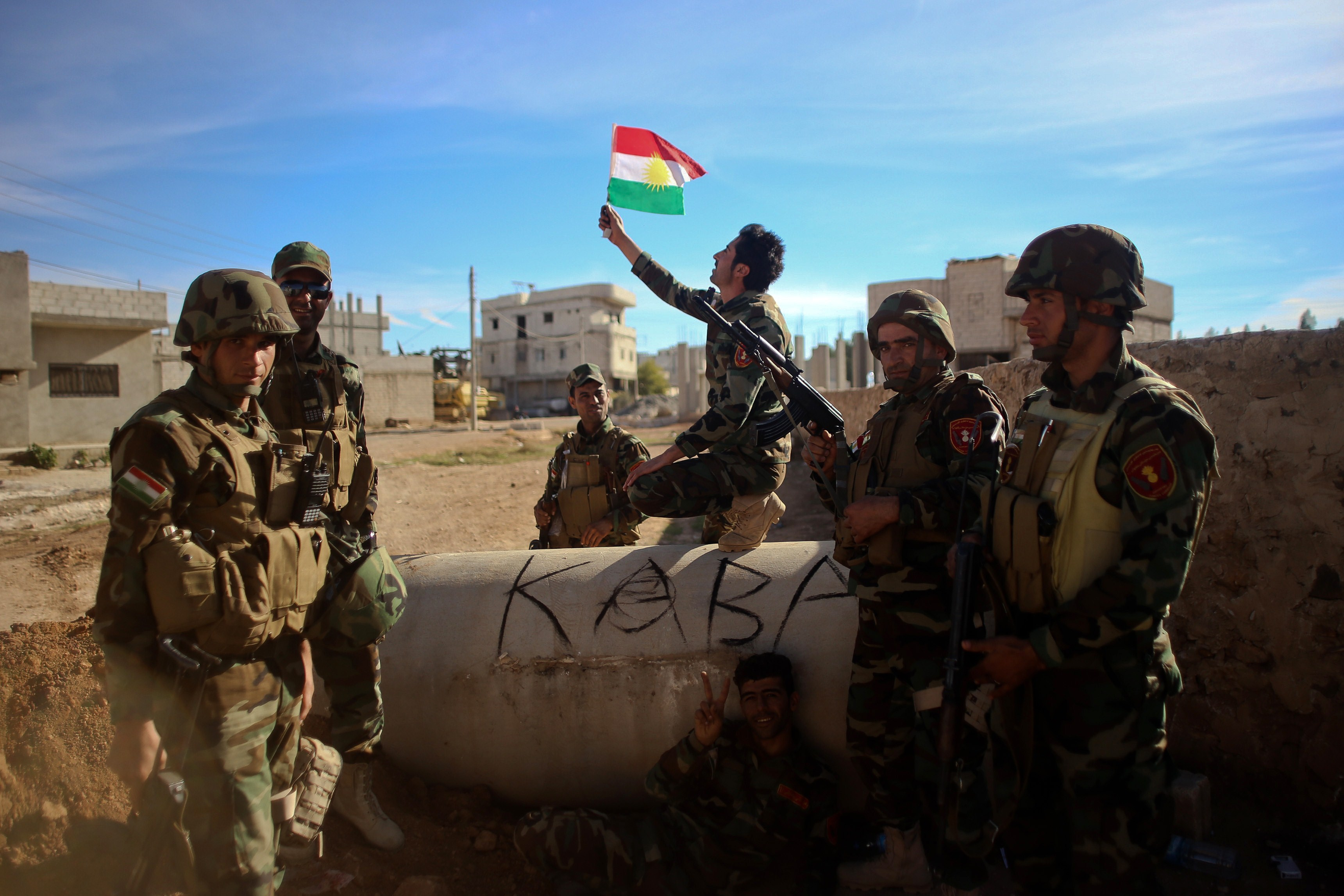 Kurdish Peshmerga fighters pose for a picture during a break in fighting against Islamic State (IS) group on November 8, 2014 in the Syrian besieged border town of Ain al-Arab (known as Kobane by the Kurds). US-led air strikes hit jihadist positions in the north and east of Syria, including an oil field, the Syrian Observatory for Human Rights said. AFP PHOTO / AHMED DEEB (Photo credit should read AHMED DEEB/AFP/Getty Images)