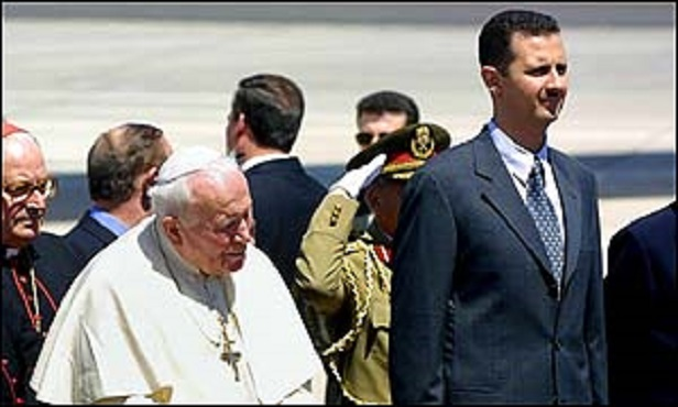 Syrian President Bashar al-Assad (R) and Pope John Paul II (C-L) listen to the Syrian national anthem upon the Pope's arrival in Damascus from Athens, 05 May 2001. The pontiff arrived in Syria on a four-day visit as part of his pilgrimage in the footsteps of St. Paul. AFP PHOTO/Gabriel BOUYS